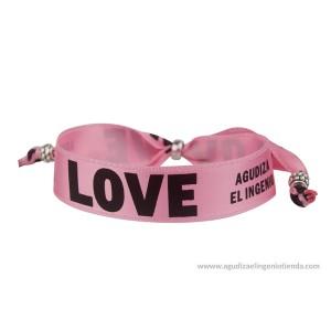 Pulsera LOVE lazo rosa